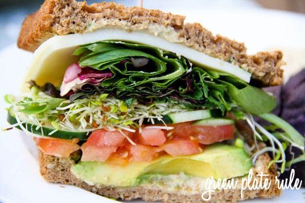 Veggie Sandwich: fresh whole wheat bread, cheese, spring mix, alfalfa sprouts, cucumber, tomato, avocado and hummus.