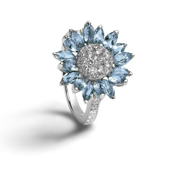 Individually set with marquise cut aquamarine petals with a pavé diamond center, all set in 18ct white gold.