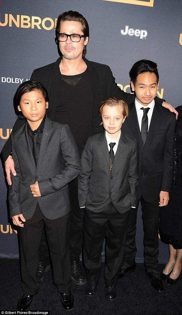 Adorable: Brad Pitt suited up with his sons Pax and Maddox as well as daughter Shiloh at the Hollywood premiere of Unbroken on Monday