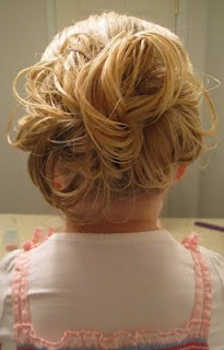 messy bun starting with rope braid...stays better in kids hair.