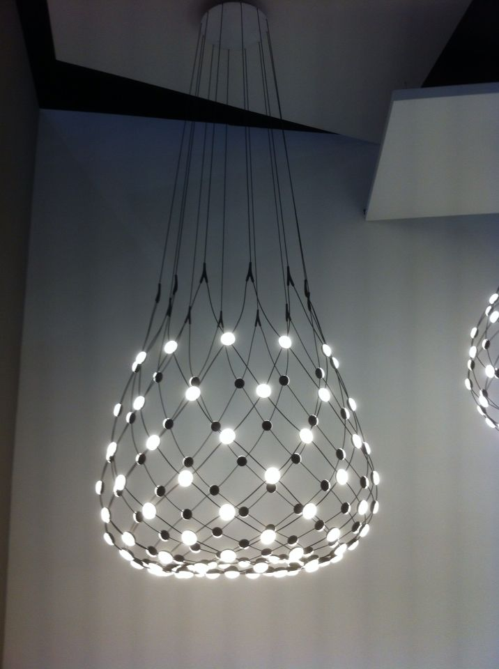 Luceplan Mesh Light by Francisco Gomez Paz at Euroluce 2015, Milan. Demonstrating the remarkable properties of LEDs, the light is constructed from a web of metallic cables and LED lights that can be turned on and off in individual sections.
