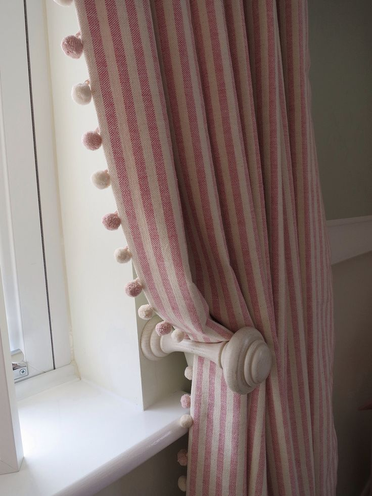 Striped curtains with pom pom trim A pair of full length pencil pleat curtains with a pom pom trim leading edge. Ivory curtain pole and matching holdbacks. Fabric and trim by Susie Watson.  Poles and holdbacks supplied by LJ Curtains. - View this photo on Flickr: http://www.flickr.com/photos/90737920@N03/16721063954