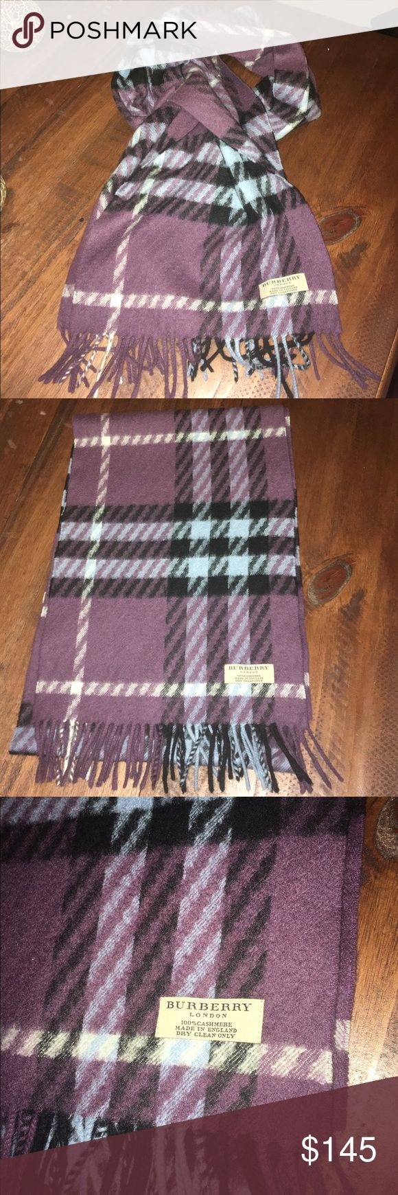 Burberry 100% cashmere scarf Beautiful (and warm!) Burberry 100% cashmere scarf in a majority of purple with slight blue and black accents. It is in great condition! Burberry Accessories Scarves & Wraps