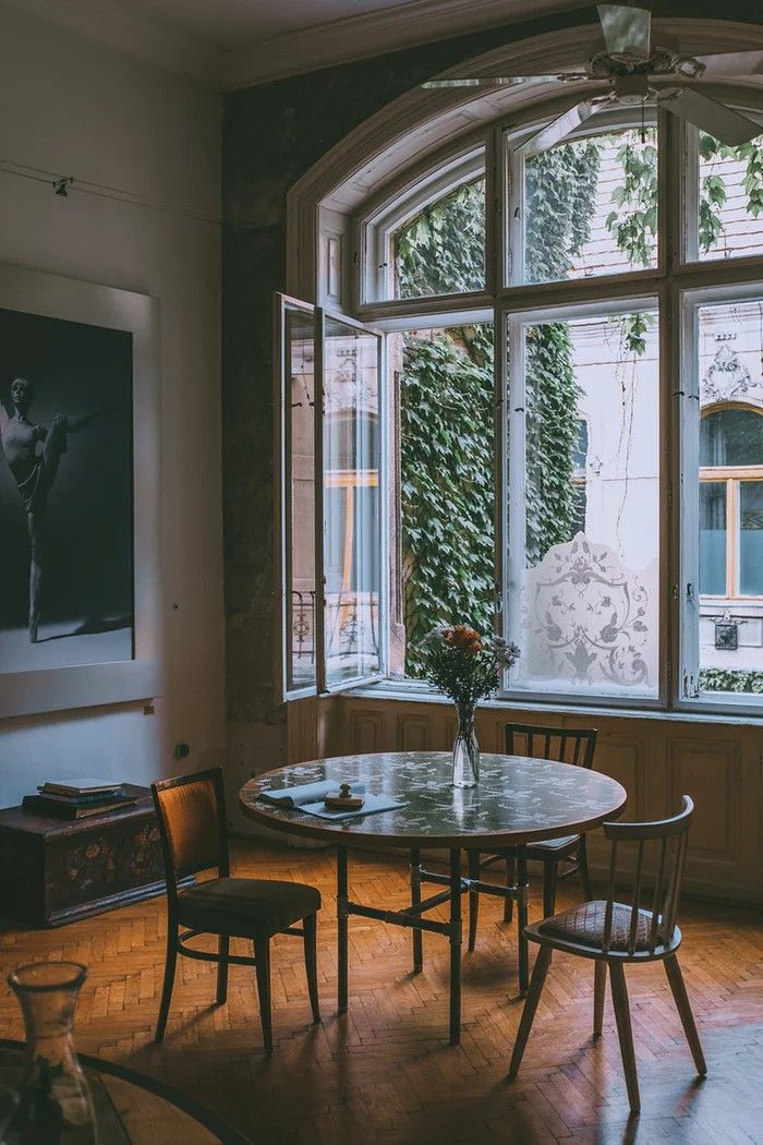 Mid Century Modern Dining Room In A Vintage European Apartment With Large Window And Round Mid Century Modern Dining Room Modern Dining Room European Apartment