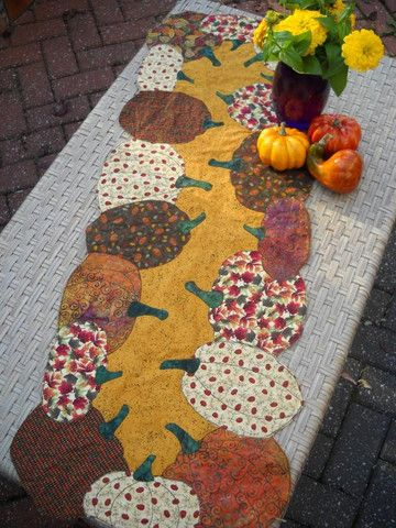 """Pattern for table topper ~20"""" x 40"""" Need a hostess gift or just a little bit of fall on your table? Because there is no batting, this becomes a quickie to make! Just fuse, turn, appliqué and finish ~"""