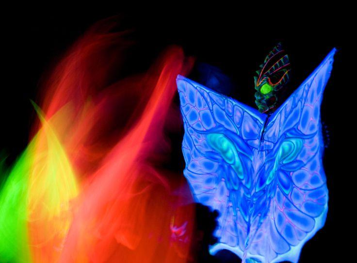 Dancer with alien butterfly wings in UV light show Anta Agni http://antaagni.com/uv-light-show/