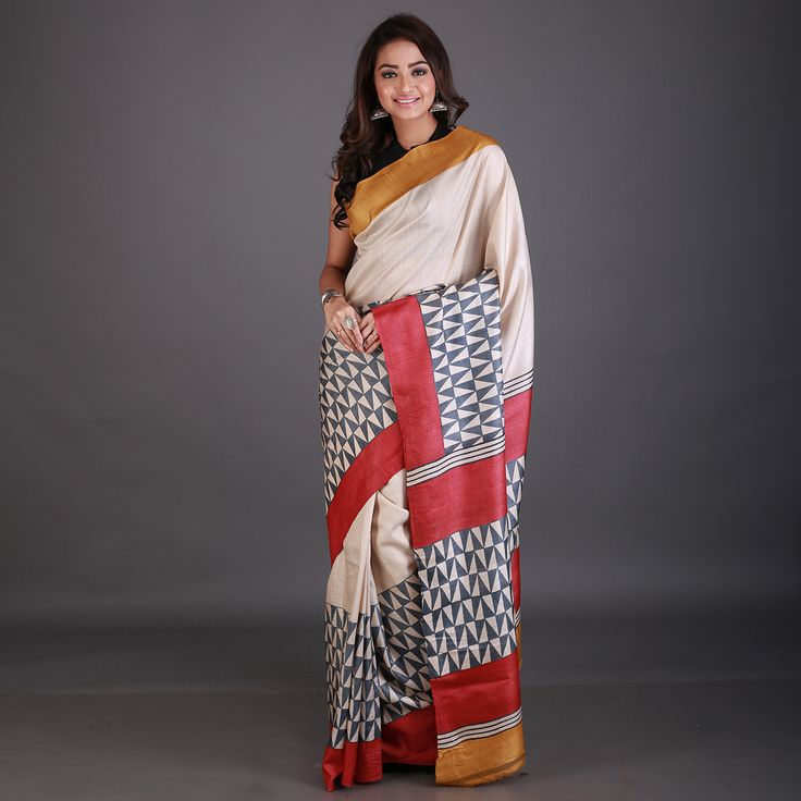 Flaunt a stunning look at parties with this Yellow Tussar Silk handloom saree. This saree is beautifully designed with hand embroidered detail and contrast border along the frills and border all over prints and embroidered detail. An unsticthed blouse is available. Note: The ornaments and blouse shown in the image are for presentation purpose only.