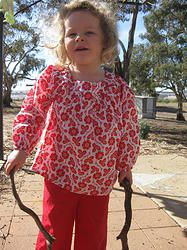 """Emmm, what can I do with these sticks? "" Breezy top in Red Floral Garden, great for covering up in the sun and helping to protect precious skin. Cool, comfortable, lightweight cotton girls top sizes 1-12 years. Designed in Australia, soft, high quality fabric made exclusively for Three Sun Possums"