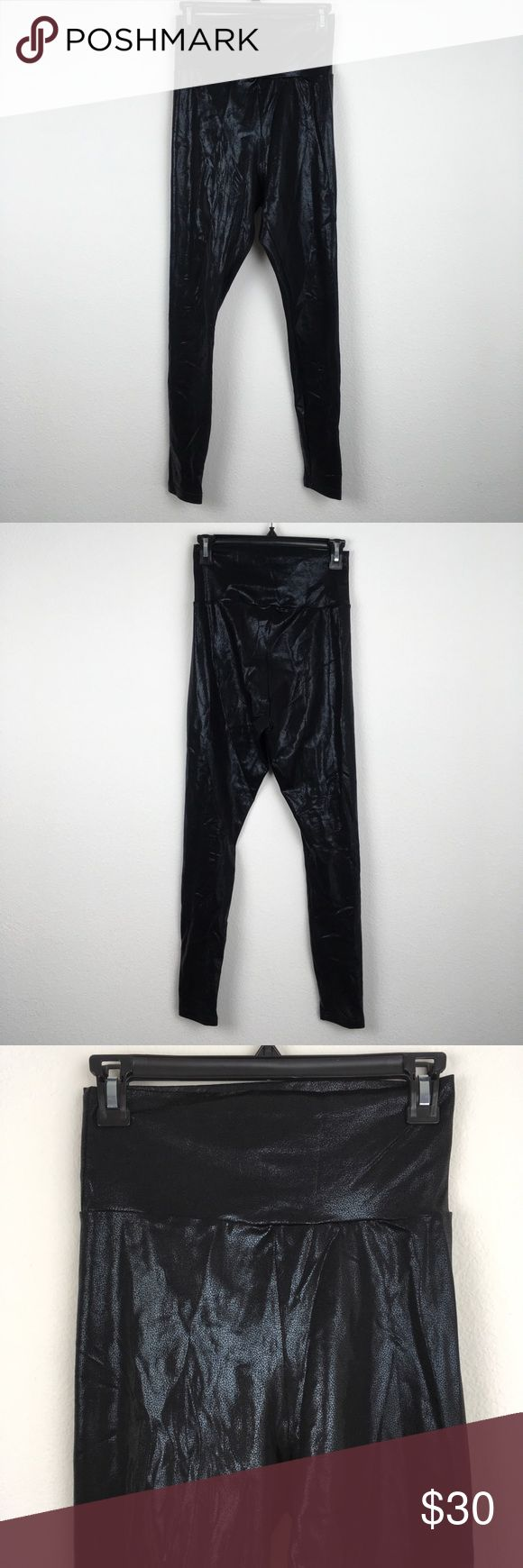 "[American Apparel] Black High-Waist Shiny Leggings Ultra high-waisted American Apparel liquid leggings. Printed and shiny. Super stretchy. Excellent used condition, no flaws, non-smoking home.   Measurements laid flat - Waist 12.5"" - Rise 13.5"" - Inseam 28""  D45 American Apparel Pants Leggings"