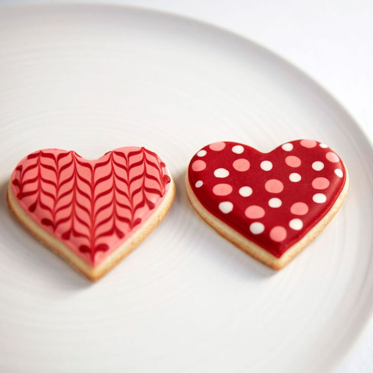 Learn to decorate sweet Valentine's Day Heart Sugar Cookies for your Valentine! We'll show you how.