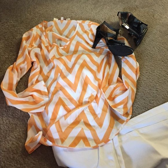 Quarter sleeve chevron blouse 100% polyester orange and white chevron quarter leave blouse. Emmelee Tops Blouses