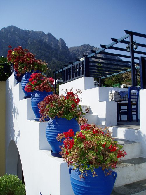 White steps and pretty red flowers - Kos, Greece