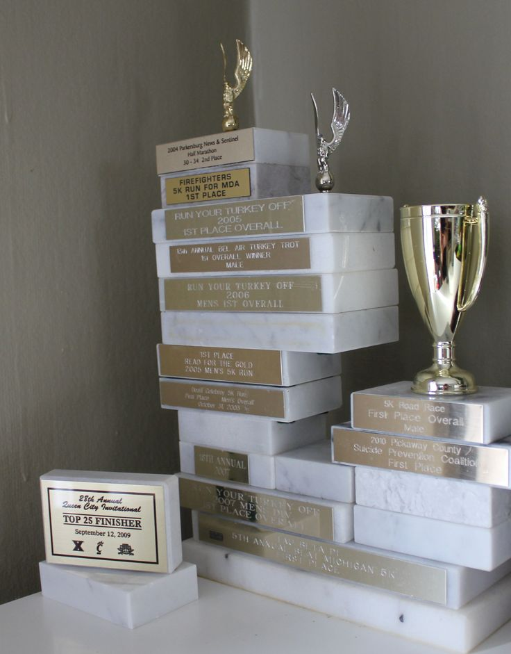 "Here's a way to display trophies without the cheesy ""metal"" running guy on top."