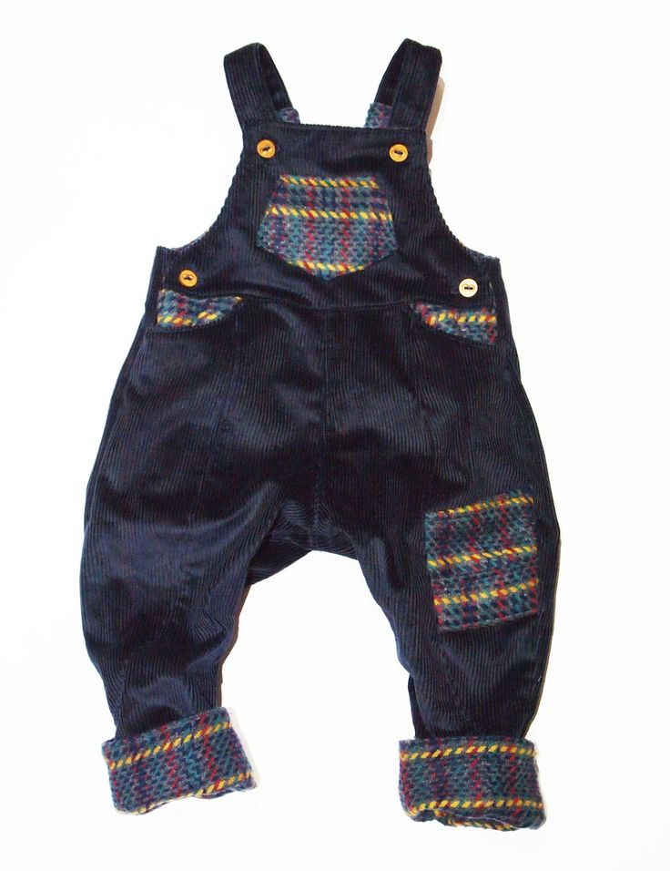 These dungarees for boys aged newborn to 3 years old are handmade with  detail and a lot of What Mother Made love!  Created in chunky blue corduroy the dungarees for boys also feature wool  check detail for contrast and texture and wooden button  double buttoned on the strap for extra length, the boys dungarees also  feature two side buttons to make changing nappies easier.   Add even more style with our new deer stalker caps here  100% corduroy and wool  machine washable at 30 degrees