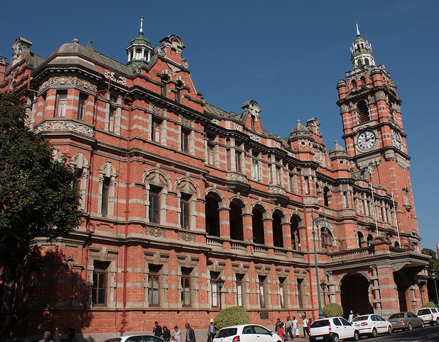Pietermaritzburg City Hall, a colonial era red brick building which dates from 1902. It was built to replace the original City Hall which was burnt down in 1898. The building was opened on August 14th 1902 by the then Duke and Dutchess of Cornwall and York. It was declared a national monument in 1969 (now known as Heritage sites).