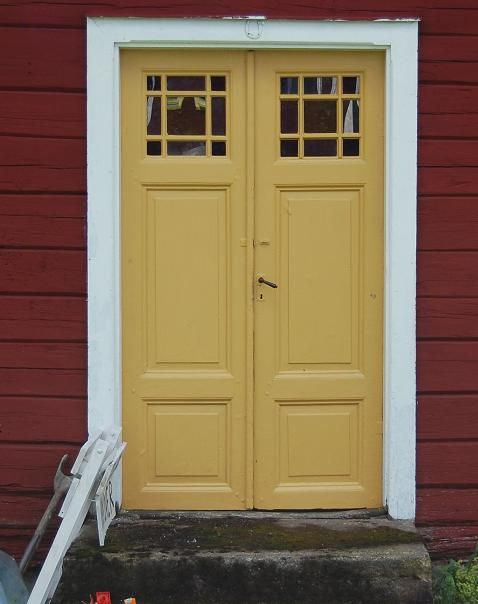 Beautiful old yellow front door.