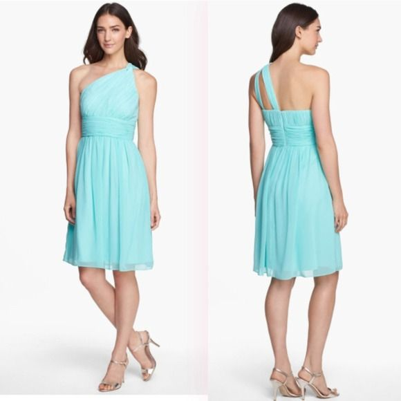 """Donna Morgan Rhea dress in spearmint (Nordstrom) Subtle ruching highlights this flowy one shoulder chiffon dress with a flattering set in waist.   - Spearmint flat poly chiffon - Asymmetrical neckline  - One shoulder  - Lined, with padded cups and rubber gripper in bodice  - Fully lined  - Fit and flare silhouette  - Concealed back zipper  - 39"""" long, approximate length from top  - 100% polyester  - Dry clean   Wore one time as MOH this summer. No alterations the dress fit me like a glove…"""