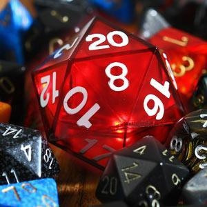 'Critical Hit LED D20 Die' on ThinkGeek, glows when you roll a 20, weighted so it is not a cheater die!