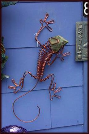 Chapel Hill, NC Metal Lizards made from one piece of copper wire with a stone head. (click image to enlarge).
