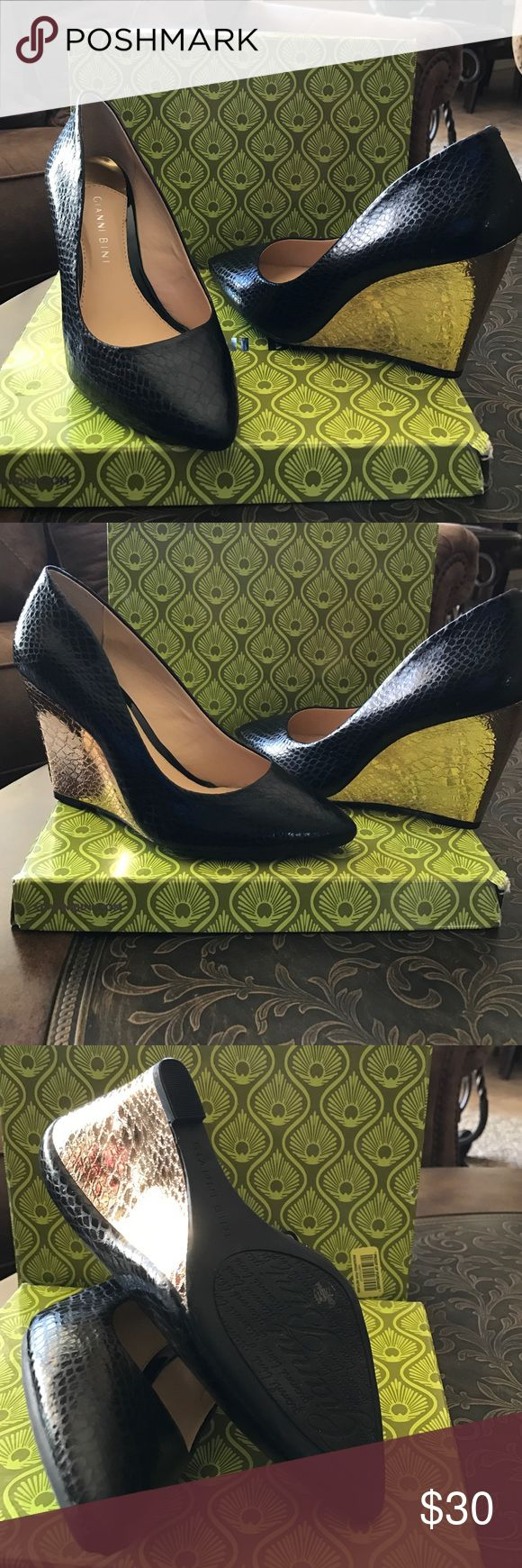 Gianni Bini beautiful shoes Brand-new black shoes with 3 1/2 gold wedge shoes, never use, excellent condition comes in the original box Gianni Bini Shoes Wedges