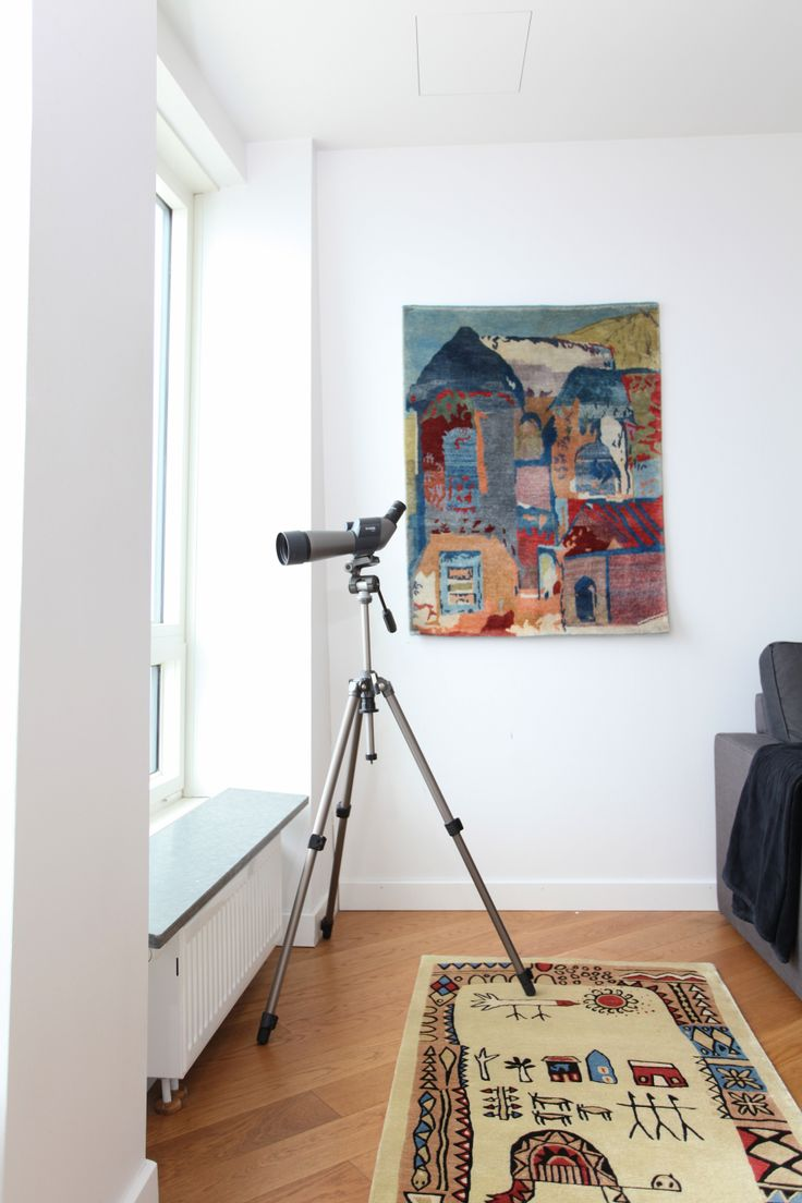 "Tola Wewe's rugs ""City In abstract"" (on wall) and ""Once Upon A Time"" work together well in this space."