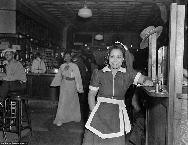 A waitress at Crawford Grill No 1, with Hugh or Hughey Smith seated on bar stool on left, c 1945-1947