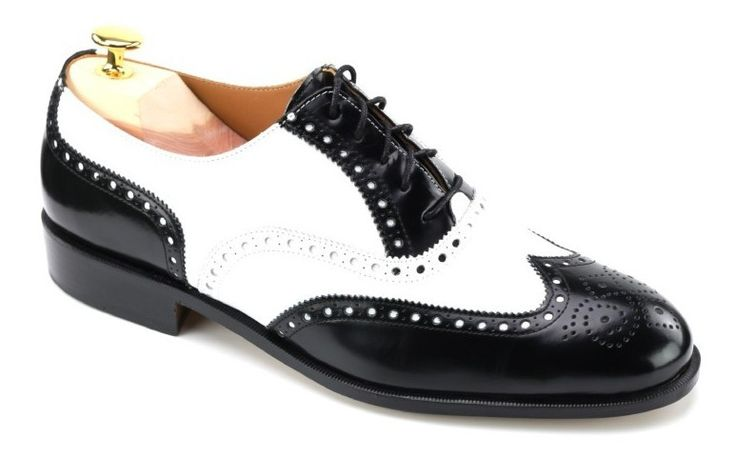 Two Tone Brogue  Mens black and white Two-tone Brogue \/ Spectator shoes High Quality European Calf Upper Fully leather lined in calf Full length padded in-sole Blake Stitched construction Slow tanned medium weight leather sole Average fit