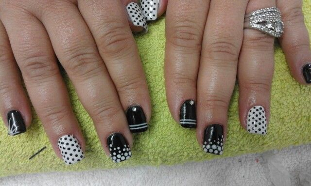 Black and white gel with free hand drawn black & white dots, white feathering, white lines finished off with silver diamontes