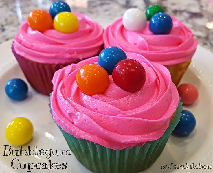 Bubble Gum Cupcakes. A delicious white cake with bubblegum flavored frosting and topped with gumballs!
