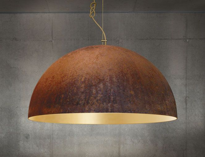 The queen contrasting corroded steel and 24crt gold combine in this highly aesthetic large pendant