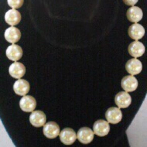 """Perfect Vintage Majolica Hand Made Pearl Necklace The name Majolica is synonymous with the worlds highest quality man made glass pearls. Every Pearl is a perfect cream color, gorgeous luster. If these 15mm pearls were real you would pay thousands. This necklace is individually hand knotted between each bead & measures 20 inches, has a very heavy, substantial feel. It is marked """"Majolica & patent number on clasp. They are gorgeous! Majolica Jewelry Necklaces"""