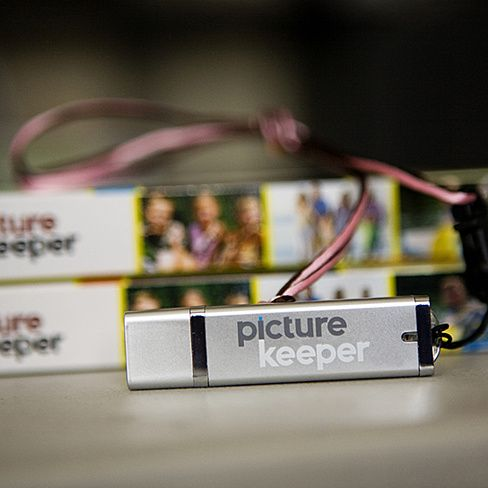 Welcome to simplicity. Back up your photos quickly and easily.   Our custom flash drives come loaded with our software and available in multiple capacities.  Why do we make things easy?  When things are complicated, people don't do them.  And when it comes to your photos, you don't get do-overs.