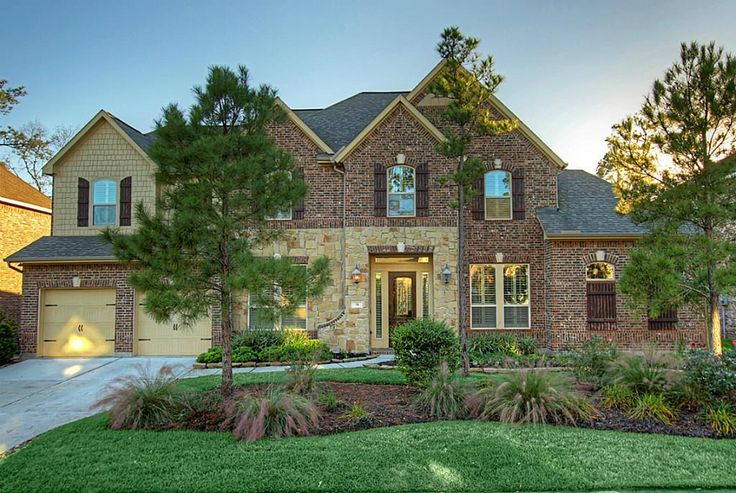 Welcome home to 34 Spotted Lily Way, a beautiful stone & brick home zoned to Magnolia School District.