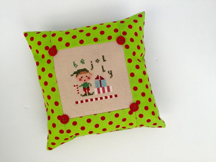 How cute is this! A new Lizzie Kate design for 2016.  Stitched on tan linen fabric, the traditional colored thread matches any holiday decor! Use as a Christmas tree ornament, festive pin cushion, or displaying on a shelf for the holidays. Size is 7 x 7.  Perfect for home decorating or gift giving!  *there is a small ink mark about the stitched L. The discounted price reflects this flaw.