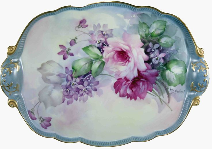 This woman paints on porcelain, and her pieces are amazing!!