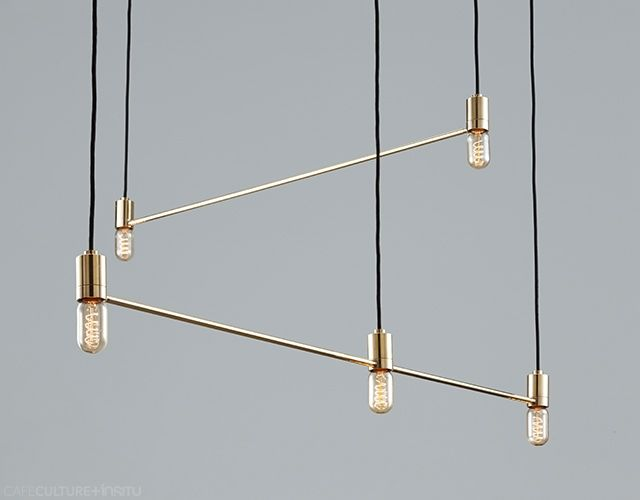 CONSTELLATION LIGHTS BY ANAESTHETIC - This collection of contemporary pendant lights represents a constellation of stars. Each star is represented by a light bulb and the connected brass rods reflect the lines typically drawn to illustrate the star pattern. Locally designed and made.