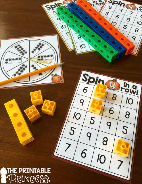 Partner or small group game. Spin the ten frame and cover. First player to cover 4 in a row on their board wins the game!