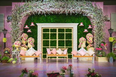 Pastel engagement stage decor , pink and green stage decor , light pink decor , girly engagement decor , grass wall , fern arches , floral arrangements, barbie decor m sangeet decor