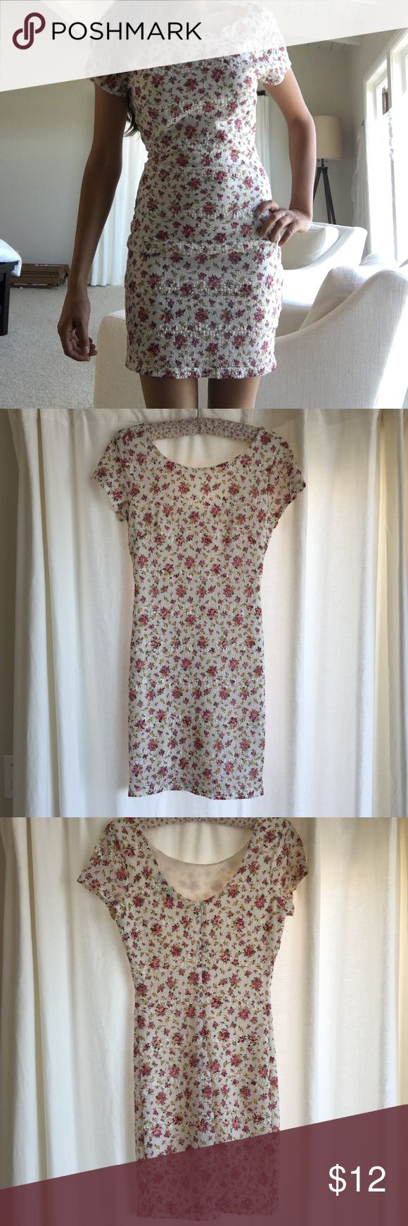 Laced floral dress Lace form fitting dress with floral print. Good quality material and very comfortable. High neckline and scoops in the back. Has back zipper. Can be worn casually or semi-formal! Forever 21 Dresses Mini