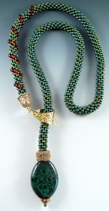 Done as a lariat with focal - from the Beaded Swan -  I like the idea of the gold focal holder for this
