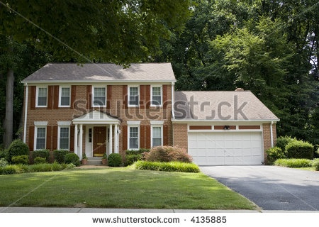 Stock Photo Two Story Red Brick House With Shutters On