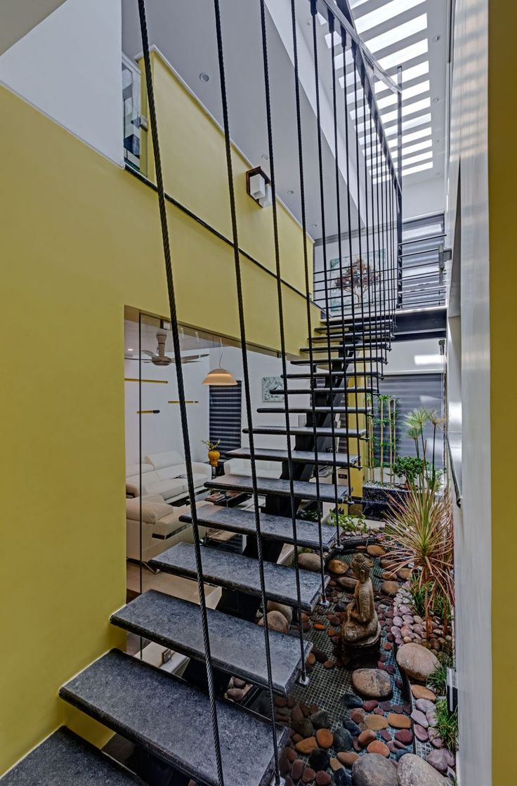 Alternating tread stair revit home design ideas - Ashwin Architects Design A Contemporary Home With Warm Yellow Highlights In Nagarbhavi India