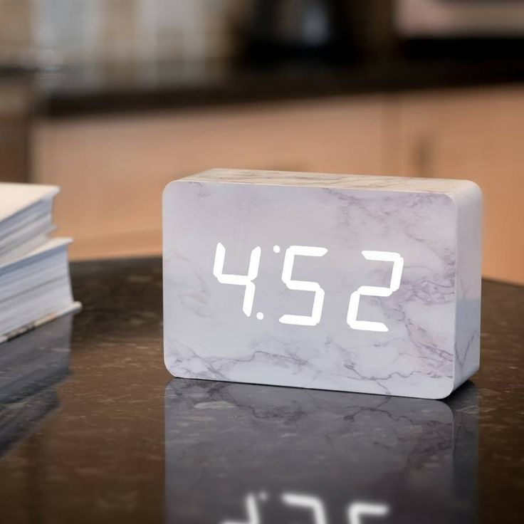 We're all slaves to time, but now it's on your terms with this Brick Marble Click Clock.Just click your fingers, clap your hands or gently tap your bedside table and the time, date & temperature will alternately appear for you in white LED colour. It automatically switches off when the room is quiet, lighting up again when the alarm goes off or as a response to your clicked fingers or clapped hands. The numbers seem to float on the lovely marble block, but that's just half the magic of this…