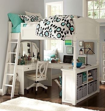 A bunk bed with a room under it