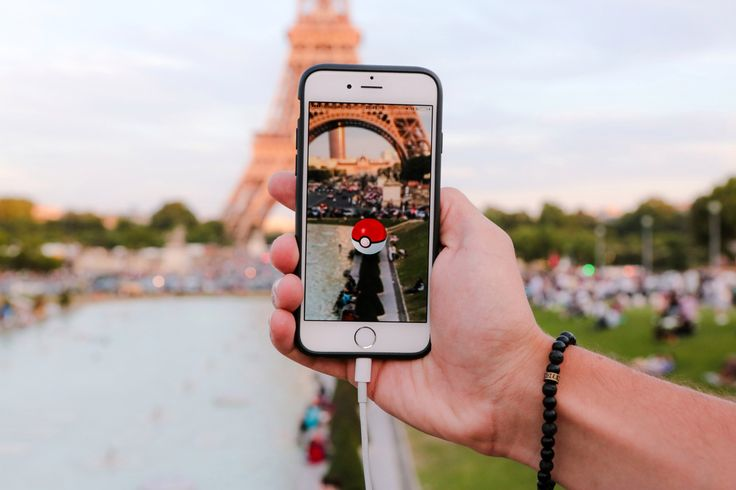 A man tries to catch a Pokemon while playing Pokemon Go at the Trocadero, in front of the Eiffel tower, in Paris, France.