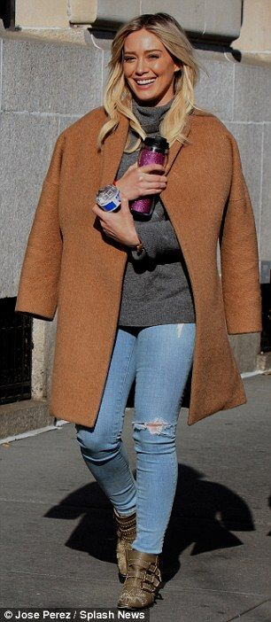 Fashion wrapped up:Despite the sun being out, the former child star drew in her stylish w...