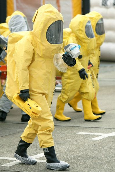 A member of the Metropolitan Police Department in chemical protection suit determines the radiation danger zone during an anti-terrorism exe...