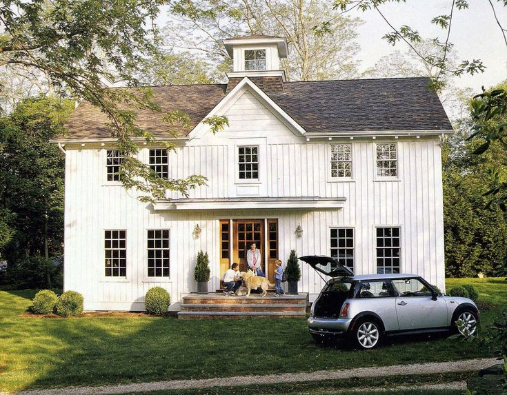 White Farmhouse Via Coastal Living March 2007
