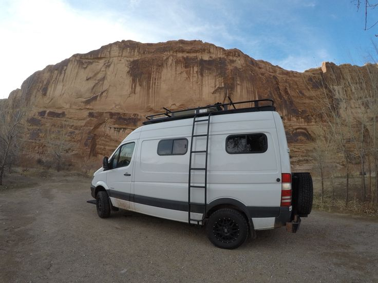 Sprinter 4x4 camper van with Aluminess roof rack and ladder and rear bumper Photo cred: Bearfoot Theory