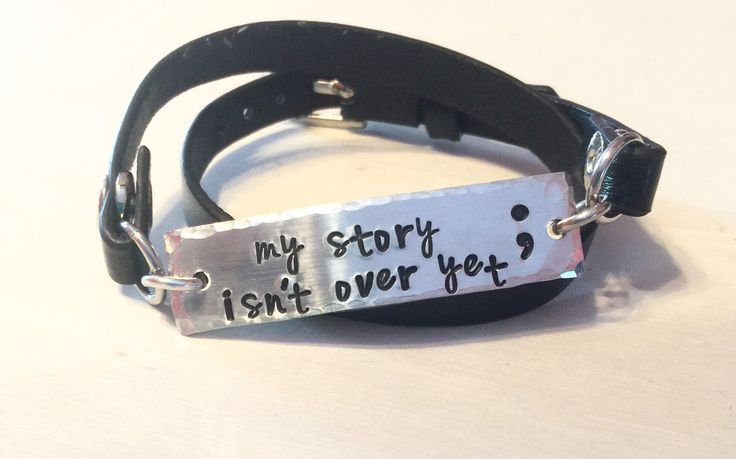 Semicolon Jewelry My Story Isn't Over Yet Leather Wrapped Hand Stamped Bracelet by NameItAlready on Etsy https://www.etsy.com/listing/247463565/semicolon-jewelry-my-story-isnt-over-yet